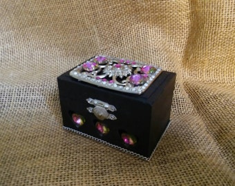 Black stash or trinket jewelry box with glass heart beads