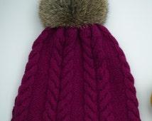 Deep purple knit hat with rabbit pom pom