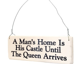 """Wood Sign Saying """"A Man's Home is His Castle Until His Queen Arrives"""" White Wood Sign With Saying in Black Lettering."""