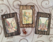 decoupaged handmade wooden wall panels, wall plaques with images of the Mediterranean town and imitation of wooden planks
