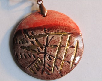 Handmade ceramic pendant, third fire with gold luster.