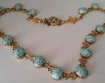 A lovely, and very unusual, turquoise flecked glass articulated choker necklace.