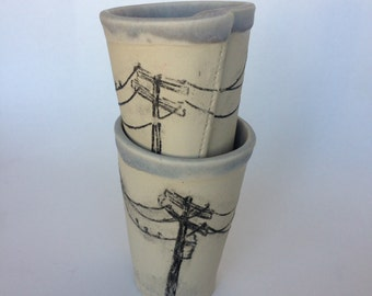 Slab-built pottery ceramic cup with embossed telephone pole