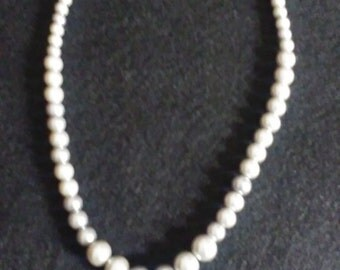 Silver pearl with caged pearl necklace