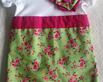 Pretty baby grow dress with corsage in newborn - 18-24 months