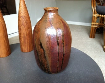vintage signed pottery piece in rich earth tone and shades of brown, slight black accent, bud vase or decorative piece