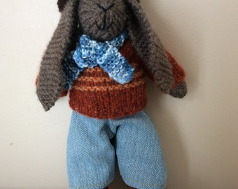 Dressed knitted cute bunny rabbit