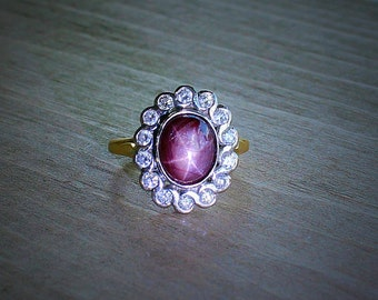 Star Ruby and diamonds in 18k gold ring