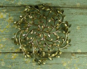 Large filigree goldtone brooch