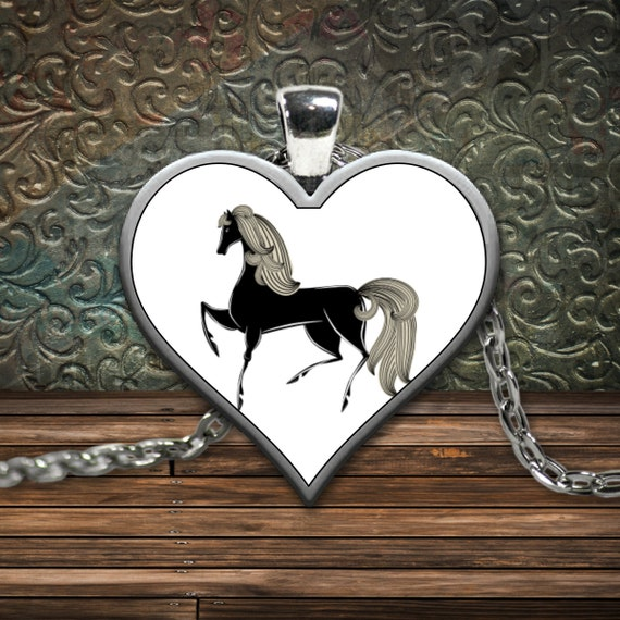 Silver plated black horse heart necklace jewelry / equestrian / heart-shaped necklace face with chain and white background
