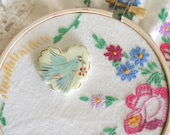 Ceramic Porcelain Heart Needleminder, Painted Blue Bird on Lime Green and Brown Background