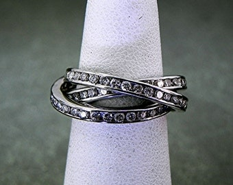 18K white gold Triple spinning ring with 2.0 Carats of Diamond channel set.
