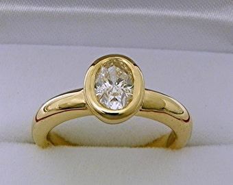 SALE 3/4 Carat Oval Diamond   7x5mm  .71 Carats  in heavy Bezel 14K yellow gold Engagement ring Stackable