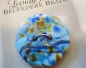 River's Edge - art glass button - sky blue, dark blue with amber and cobalt blue speckles  - two hole