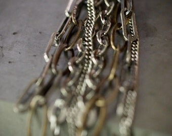 Fun, flirty long multi chain mixed metal earrings