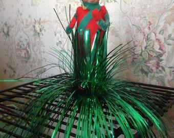 Vintage elf hiding in garland decoration