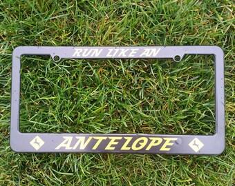 Run Like an Antelope License Plate Frame