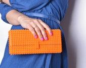 Orange clutch made entirely of LEGO bricks