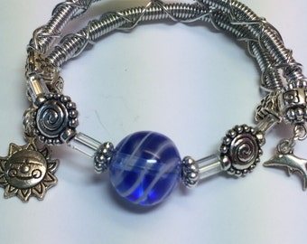 Memory Wire Bracelet with Royal Blue Glass Bead and Charms