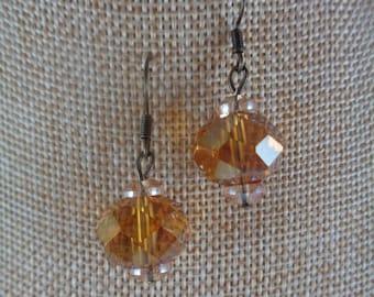 Amber-colored glass bead dangle earrings