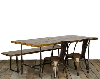 "Reclaimed wood dining table with 1.65"" reclaimed wood top and steel pipe legs"