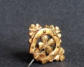 Lucky horseshoe and clover vintage pin brooch. Antique golden amulet gift giving idea and jewelry making supply.
