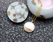Porcelain necklace, white with gold line pattern