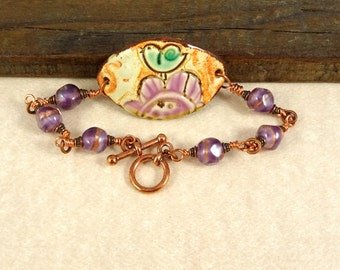 """Ceramic Link Bracelet - Purple Flower with Aqua Bird - Lampwork Beads in Purple and Copper - 8 1/2"""" length with Toggle Clasp"""