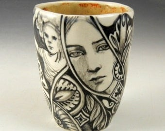 Story cup or tea bowl, black and white with faces, bird, jester and more