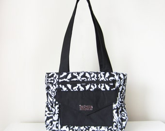 Women's Shoulder Bag / Tote Bag with Pockets and Zip Closure in Black and White