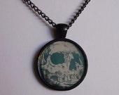 SALE teal melted skull resin pedant necklace