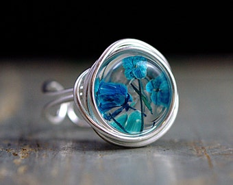 Sterling flower nest ring. Wrapped ring with real turquoise blue flowers in resin. Adjustable ring for her. Gift.