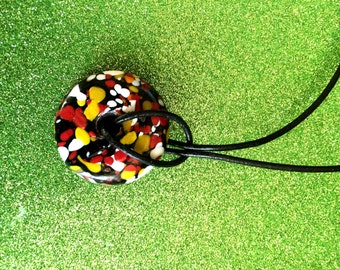 Black White Yellow Red Glass Patterned Donut on Black Leather Fashion Trend Pendant Necklace by JulieDeeleyJewellery on Etsy Ladies Jewelry