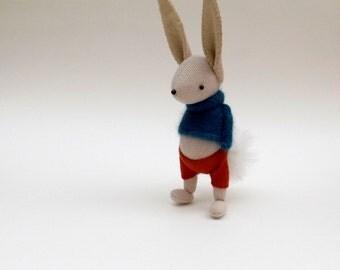 Cream Woollen Rabbit  -  Handmade woolly plush rabbit wearing blue woollen pullover and felt pants.