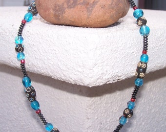 Turquoise Glass and Bejeweled Clay Barrels offset by tiny pops of red.