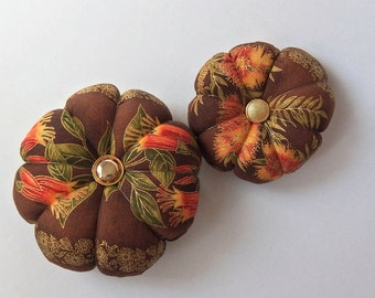 Pincushions Native Flowers Fabric . Great for a sewing gift - Round Pin cushion. Australian floral fabric with gold accents. pins holder