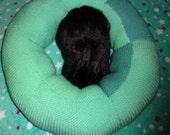 Ugli Donut rabbit bed for a small sized bunny hand knit