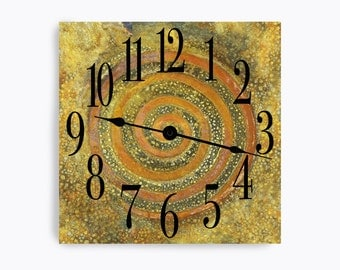 Green and yellow wall clock with rust swirl and speckles. Square design.