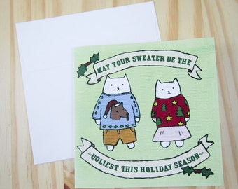 "CARD: ""Ugly Sweater Cats"" featuring two cats wearing ugly Christmas sweaters"