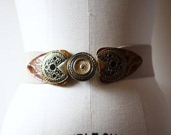 1970s tan elastic belt // arrowhead belt // vintage belt