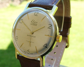 A gents 1960s Elco Extra Flat wrist watch.