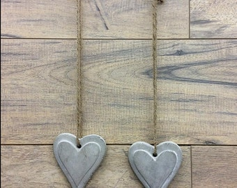 Rustic cement hearts on a string. Lovely for home or wedding decor, wedding favors, place names, name tags and vintage decor.