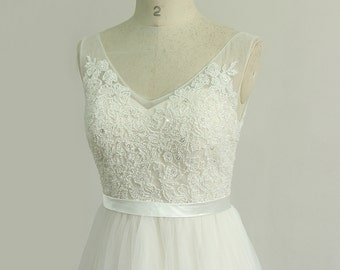 Open back Romantic ivory a line lace beach wedding dress with elegant beaded top and pale blush lining
