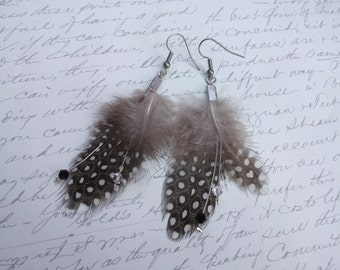 Feather earrings with crystals