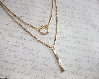 Double layer gold necklace with ring and bar