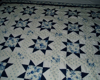 Hand quilted lap couch quilt in Delft blue