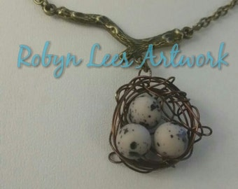 Sparrow's Egg Bead Bird Nest Necklace on Bronze Tree Branch and Bronze Crossed Chain