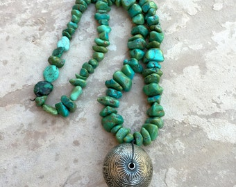 Ethnic necklace with vintage chunky turquoise and India silver decorated feature bead