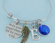 Angel wings bangle bracelet in stainless steel personalized with your choice of initial and birthstone.  Angel Wing bracelet.  Angel Wings.