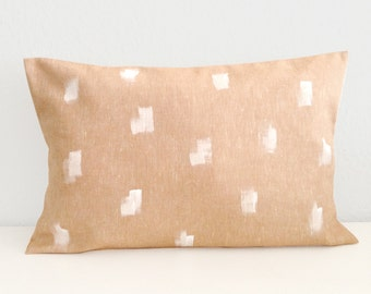 Cushion cover with a white pattern